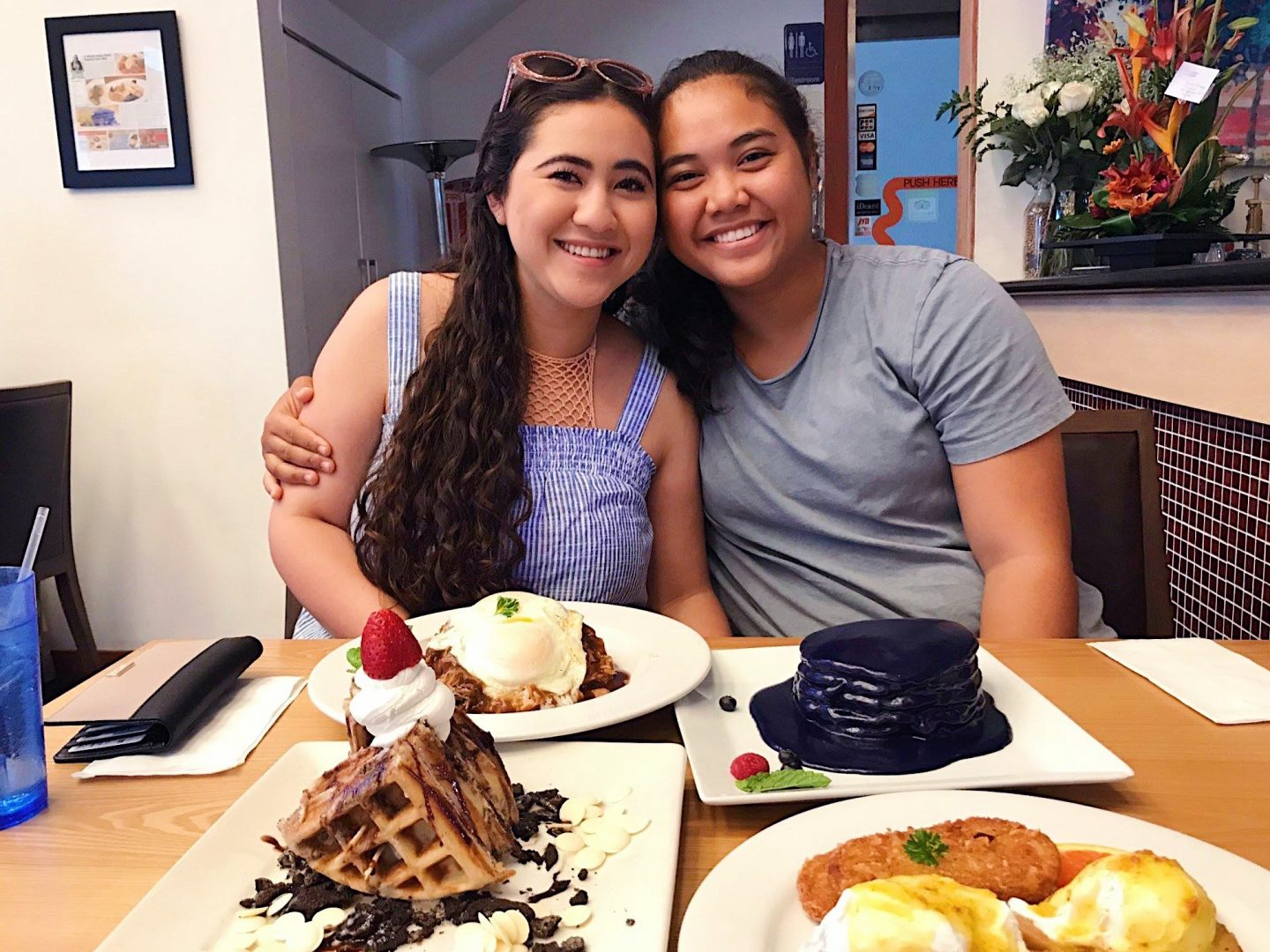 Noelle and Kaiʻolu at breakfast