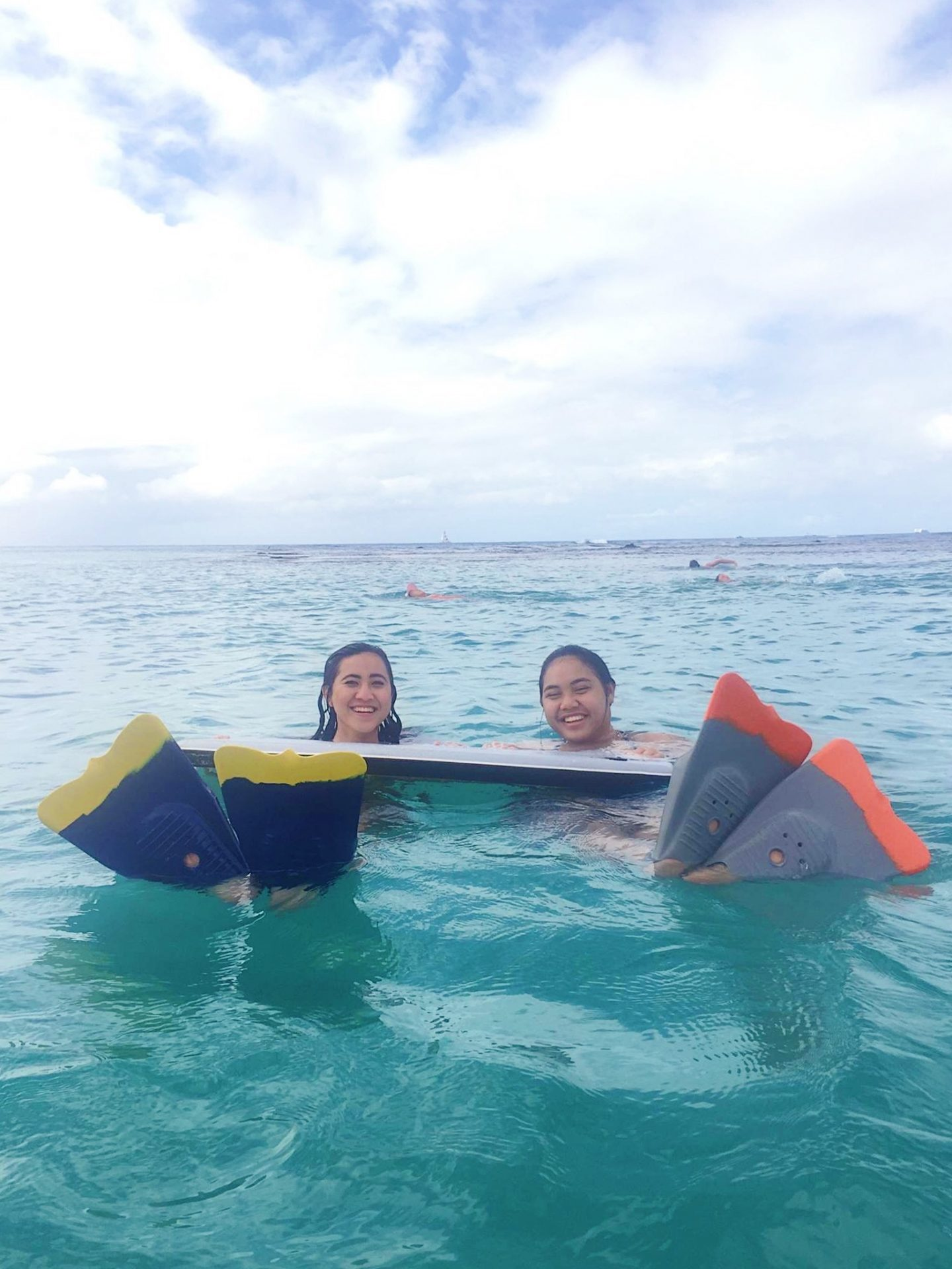 Noelle and Kaiʻolu in the ocean